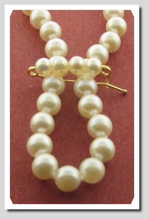 Pearl shortener w/4 white pearls, 14K Yellow Gold